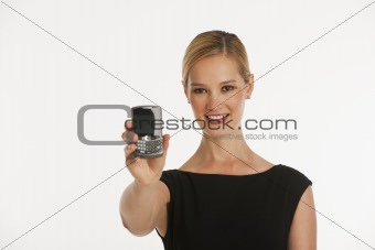 business woman holding up phone towards camera with copy space
