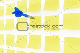 Postit notes with dart arrow