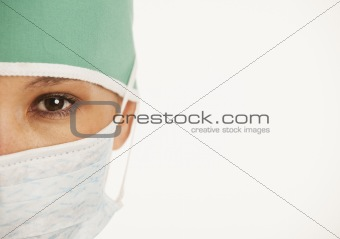 close up of doctor's eye with scrubs on and copy space
