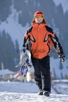Lucky boy  snowboarder in a mountain valley
