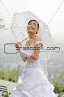 Bride with umbrella