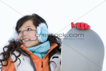 Laughing beautiful girl snowboarder