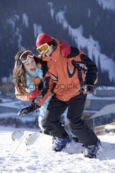 Couple of young snowboarders