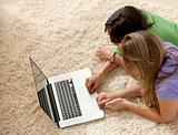 Women on the floor with a laptop
