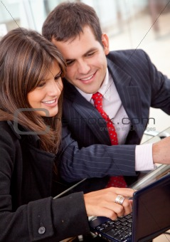business couple on a laptop