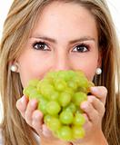 Woman with grapes isolated