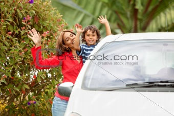 Mother and son with a car