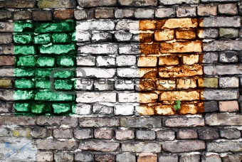 Flag of Ireland on an old brick wall