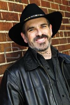 Bearded man in cowboy hat