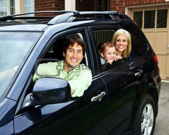 Happy family in car