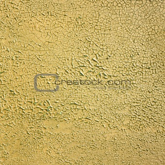 Painted peeled concrete yellow wall