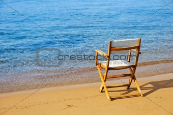 Chair on a golden sandy beach