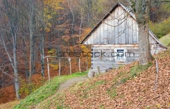 Small house on autumn mountains