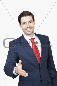 business executive in suit stretching out his hand for handshake - clipping path