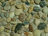 Concrete background with small stones