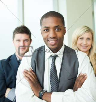 Afro-American businessman with his colleagues smiling at the cam