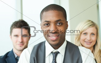 Portrait of an Afro-American businessman with his colleagues