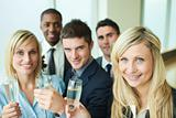 Businesspeople toasting with champagne