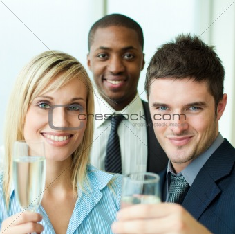 Portrait of businesspeople toasting with champagne