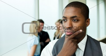 Thoughtful ethnic businessman in office