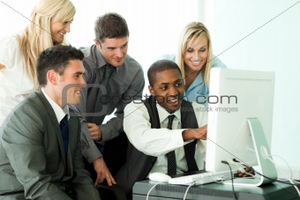 Afro-American businessman explaining a job to his team