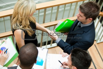 Business team discussing about reports and documents on stairs