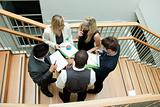 High view of business team having a meeting on stairs