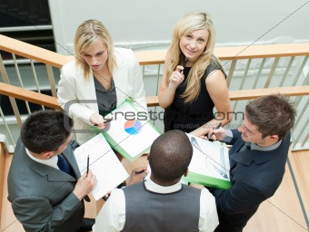 Business people having a meeting on stairs