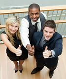 Business people on stairs with thumbs up