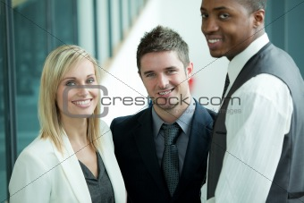 Business team smiling at the camera standing on stairs