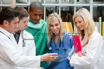 Group of doctors speaking in a hospital