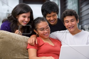 Teenagers watching something on laptop