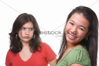 Happy and unhappy female teenagers