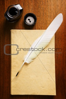 Old blank paper and quill pen