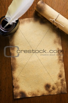 Old paper, quill pen and scrool on wooden paper