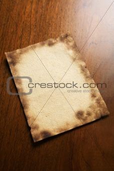 Old blank paper and scroll on wooden table