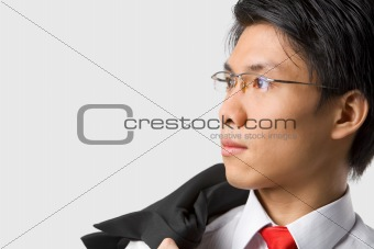Asian businessman looking away