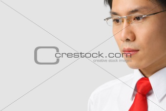 Asian businessman looking away to empty space