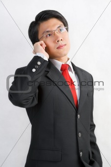 Asian businessman talking on the phone