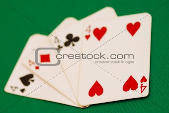 Four old playing cards