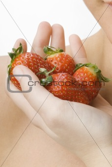the hand full of strawberry