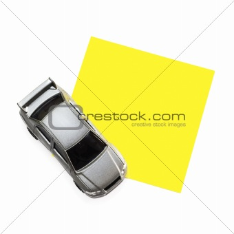 Post-It Note with Car Toy (isolated on white)