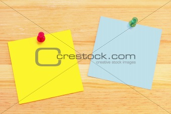 Post-It Notes on Wood Desk