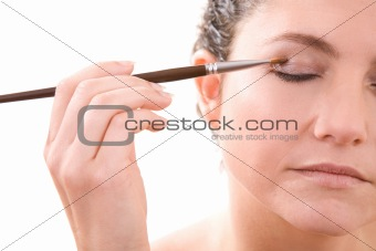 Applying eye shadow