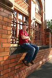 Child sitting on brick wall