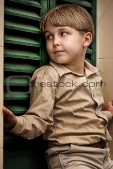 Boy at shuttered window
