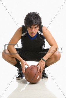 Basketball player bend on knee