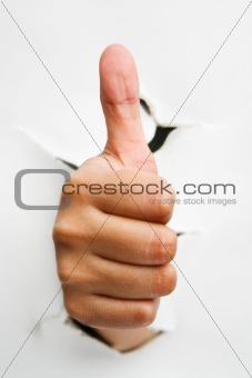 Thumb up from crack wall