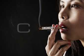 Woman smoking on dark area