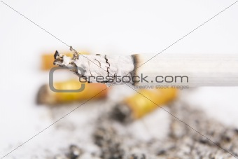 Burning cigarettes on ashtray